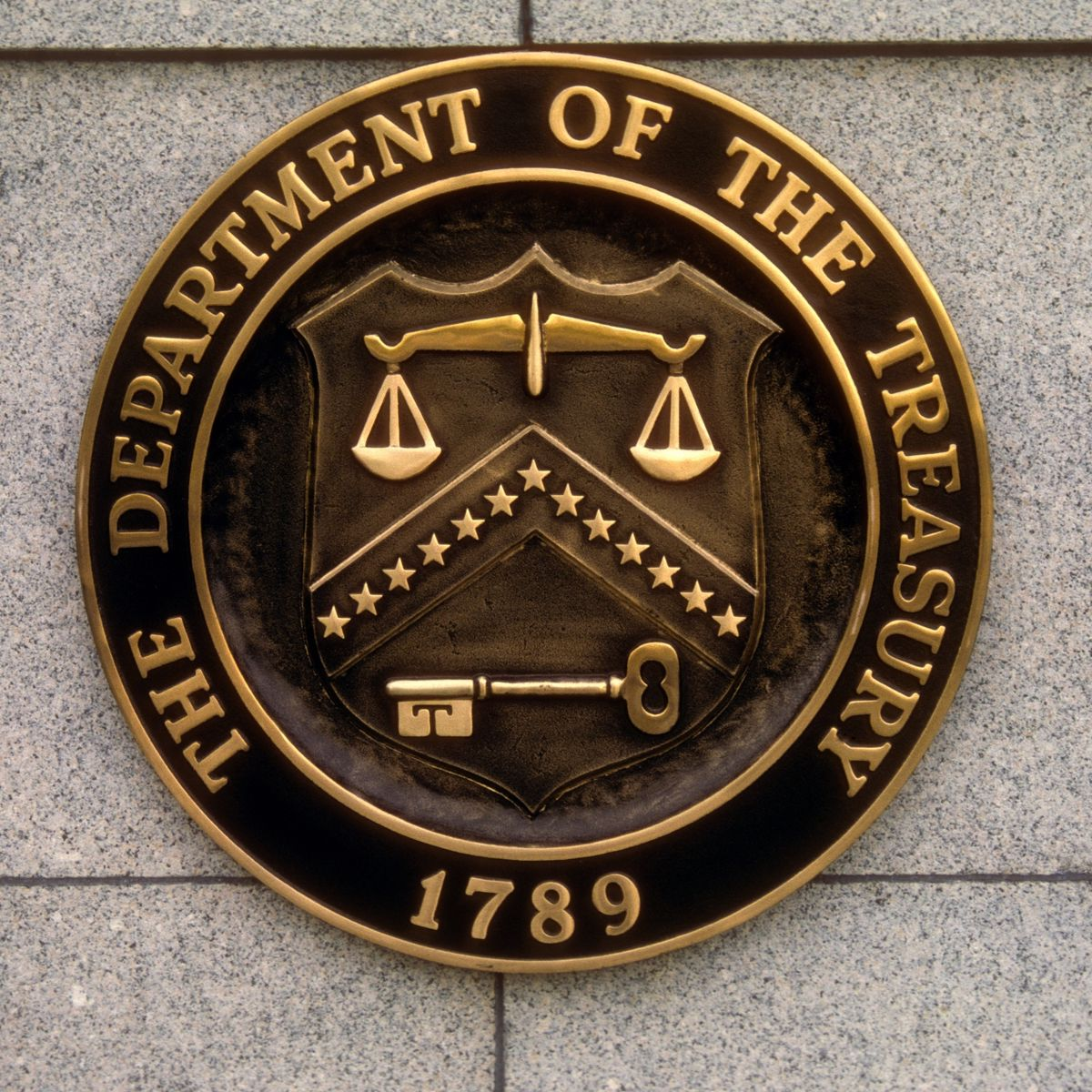 seal of the U.S. department of the treasury on building exterior